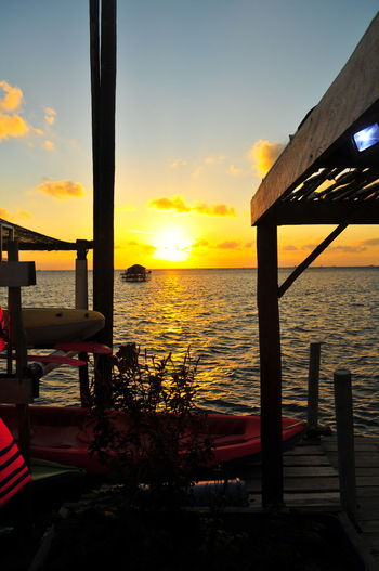 Orange Illustration Sunlight EyeEm Selects EyeEmBestPics Mood Sunrise_sunsets_aroundworld Sunrise Summer Warm Kayak Water Sea Sunset Reflection Sky Horizon Over Water Architecture Cloud - Sky Built Structure Seascape Dramatic Sky Romantic Sky Atmospheric Mood Silhouette Moody Sky Ocean Cloudscape Atmosphere