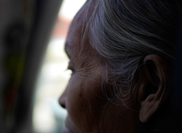 Close-up of senior woman with gray hair