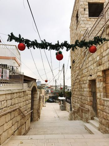 Built Structure Architecture Building Exterior Hanging City Sky Outdoors The Way Forward No People Clear Sky Low Angle View Day Tree Christmas מייאייפון7 מייפסוטה מייסטריט מייחגים Adapted To The City