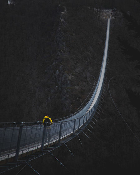 Athlete Bridge - Man Made Structure Built Structure Day Footbridge Full Length High Angle View Leisure Activity Lifestyles One Person Outdoors People Railing Real People Sport Lost In The Landscape