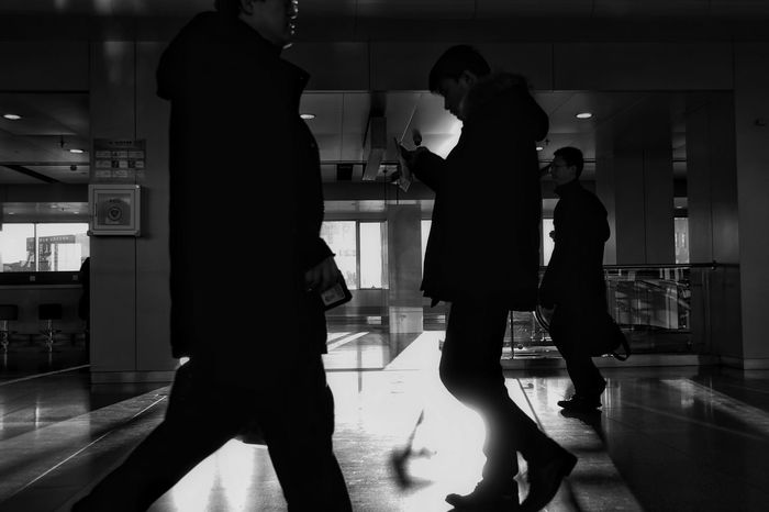 China Photos Airport People Watching Blackandwhite Busystranger Travel Showcase: January Taking A Break Light And Shadow Streamzoofamily