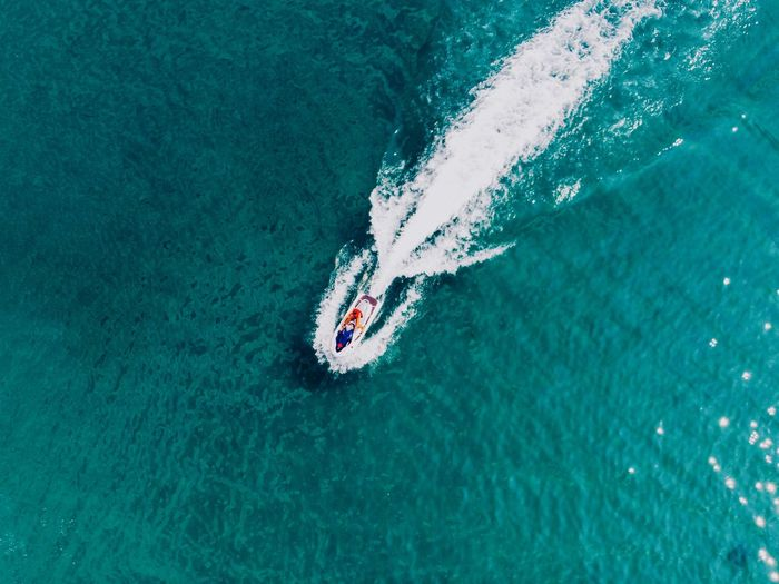 top view of the azure seashore Water Sea Sport High Angle View Real People Lifestyles Day Outdoors Swimming Aquatic Sport Turquoise Colored Leisure Activity Motion Nature Waterfront One Person Unrecognizable Person Sunlight