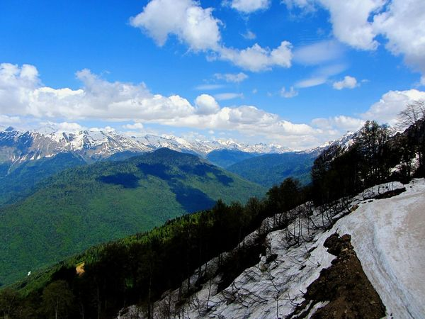 Mountain Mountain Range Snow Landscape Beauty In Nature Scenics Nature Cold Temperature Sky No People Spring At The Mountains Russia Caucasus Mountains Clouds So High Green Changes Of Seasons