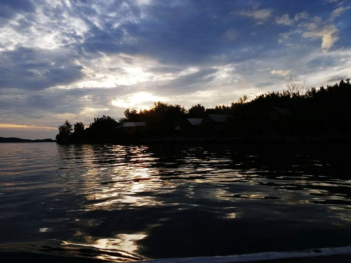 Beautiful Sunset in Hoga Island The best place for holiday with tradisional Atmosphere Of Peace