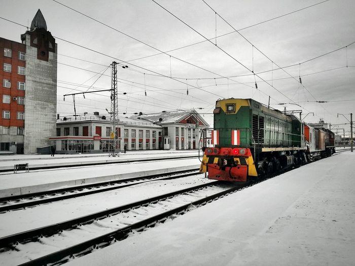 Steam train arriving at platform