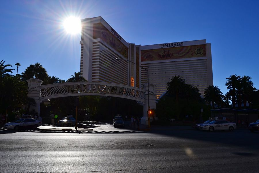 Sunlight Lens Flare Clear Sky Sun Street Transportation Built Structure Sky Land Vehicle Architecture City The City Light Building Exterior Car Outdoors Tree No People Road Illuminated Day Mirage Hotel Sunlight Nofilter#noedit EyeEm Best Shots Las Vegas