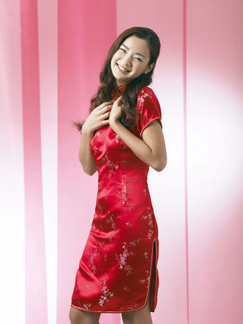chinese woman wearing red cheongsam Red Happiness Laughing Tradition Traditional Clothing Woman Chinese Chinese New Year Cultural Fashion Model Festival Glamour Gong Xi Fa Chai Happiness Lifestyles Long Hair Looking At Camera One Person Oriental Style Portrait Qipao Red Lipstick Smile Traditional Costume Wearing