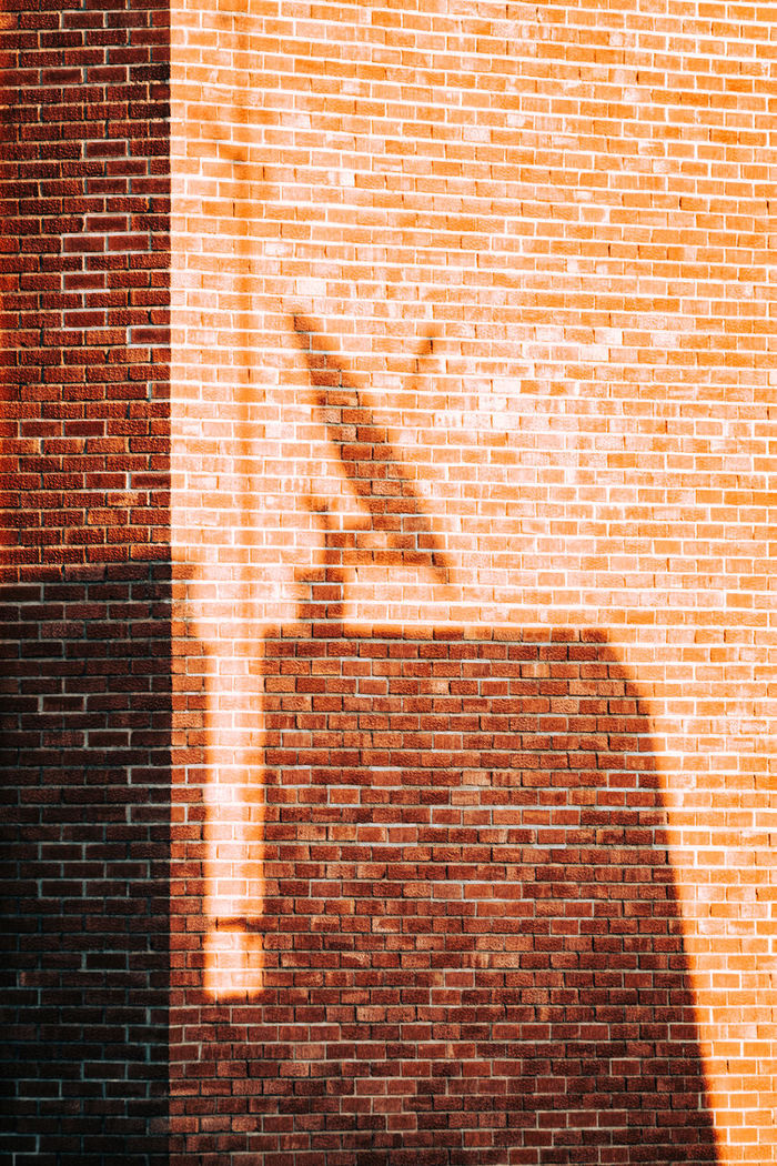 Shadow on red brick wall