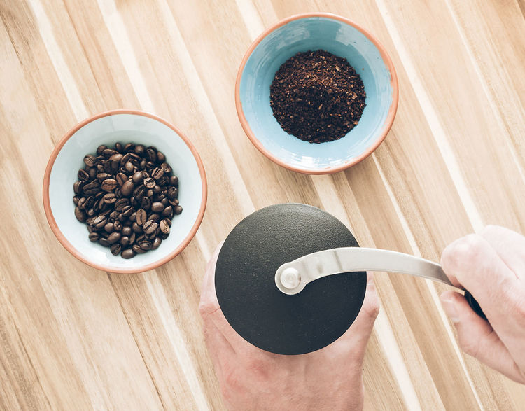 Bowls Ceramic China Close-up Coffe Beans Coffee - Drink Coffee Grinder Directly Above Drink Food Food And Drink Freshness Grinding Ground Coffee High Angle View Human Body Part Human Hand Indoors  Pottery Preparation  Table Top View