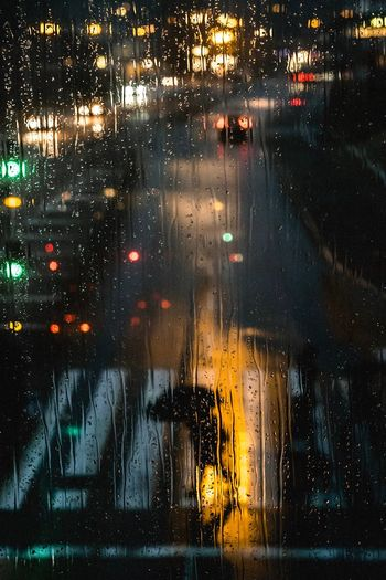 Things yet to come Fujifilm_xseries Fujifilm Streetphotography Cinematography Bokeh Wet Transportation Glass - Material Illuminated Rain Mode Of Transportation HUAWEI Photo Award: After Dark Window Night City Drop Rainy Season Water Street