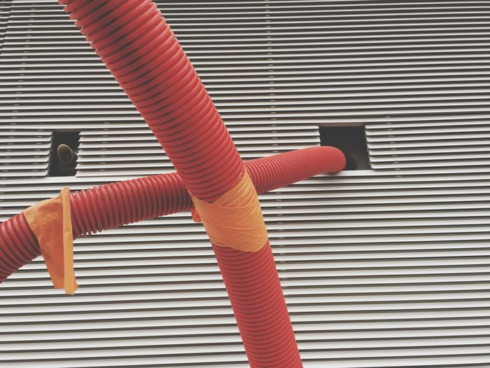 Close-up of plastic pipes at factory