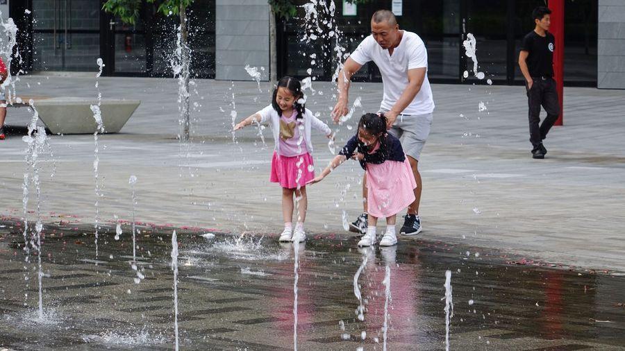 People enjoying at fountain