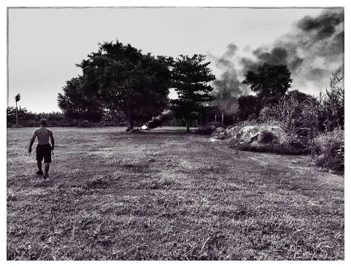 Somewhere in The Redlands a man cleans his farm by burning his garbage. Brian Soko Agriculture The Redlands South Florida Migrant Workers Burning