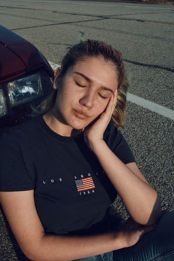 times like these Outside Thinking Streets Clothing Blue Close Up American Flag Blonde Hair Distress Model Vintage Bummed Out Modeling Shirt One Person Adult People Adults Only Only Women Young Adult Portrait One Woman Only Day One Young Woman Only Outdoors Close-up