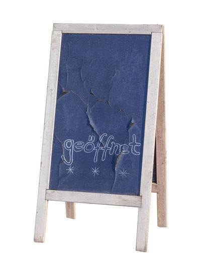 Opened sign in German language Bavaria Sign Artboard Blackboard  Blue Chalk Close-up Communication Cut Out Day Germany Geöffnet No People Opened Studio Shot Table White Background