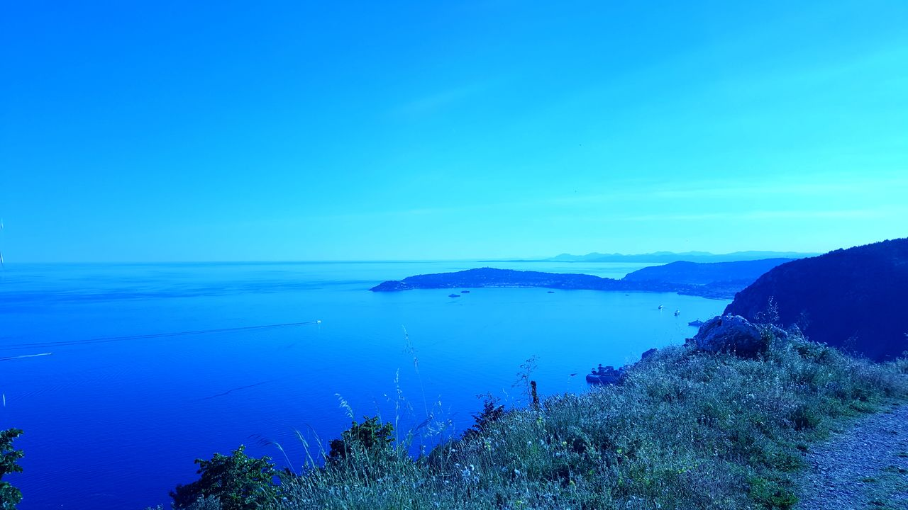 blue, tranquil scene, tranquility, nature, scenics, beauty in nature, water, sea, no people, outdoors, clear sky, horizon over water, day, mountain, sky, landscape