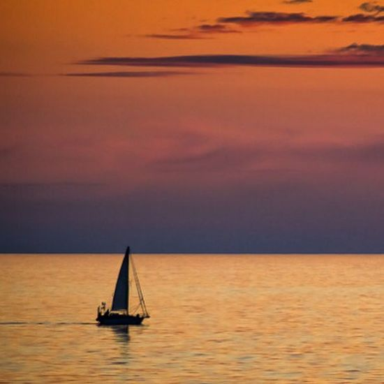 Do not go where the path may lead, go instead where there is no path and leave a trail. Sunset Silhouettes Ocean View Boat Orange Sky