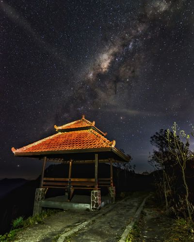 Gazebo against star field sky at night
