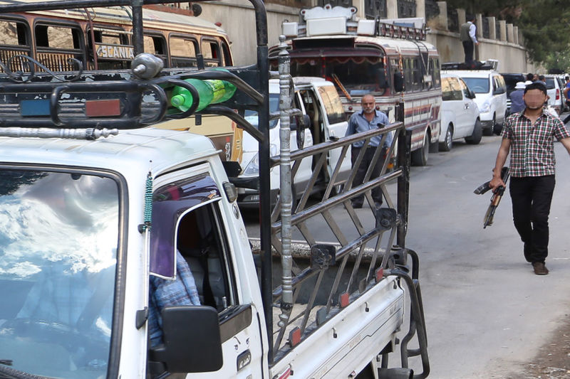 Panoramic view of vehicles on road