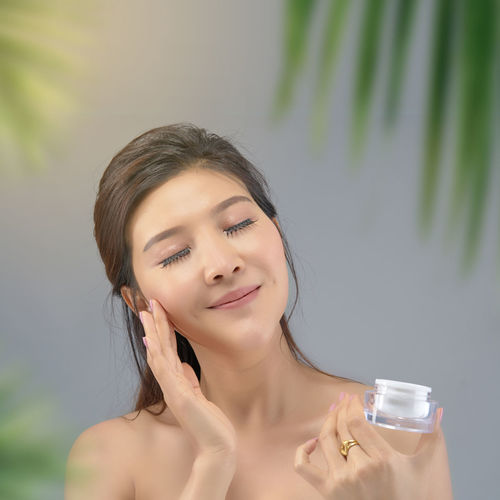 Happy beautiful asian girl with the fresh skin with sunlight background. Expressive facial expressions. Summer holiday concept. Beauty Beautiful Woman Portrait Summertime Summer Holiday Sun Block Sun Light Body Care Facial Hair Freshness Happy Joyful Skin Skin Care Treatment Wellness