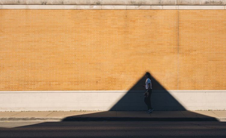 Tip top Shadow Sunlight Day Outdoors Real People Wall Brick Wall EyeEm Best Shots The Street Photographer - 2017 EyeEm Awards Paint The Town Yellow