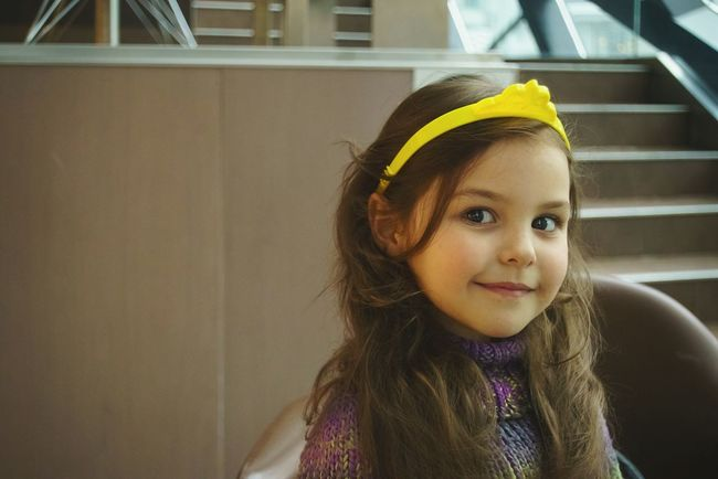 Childhood Children Only One Girl Only Child One Person Portrait Front View People Looking At Camera Indoors  Day Close-up Human Face Real People Beauty Princess Little Princess Headshot Brown Hair Smiling Yellow Cute Smile