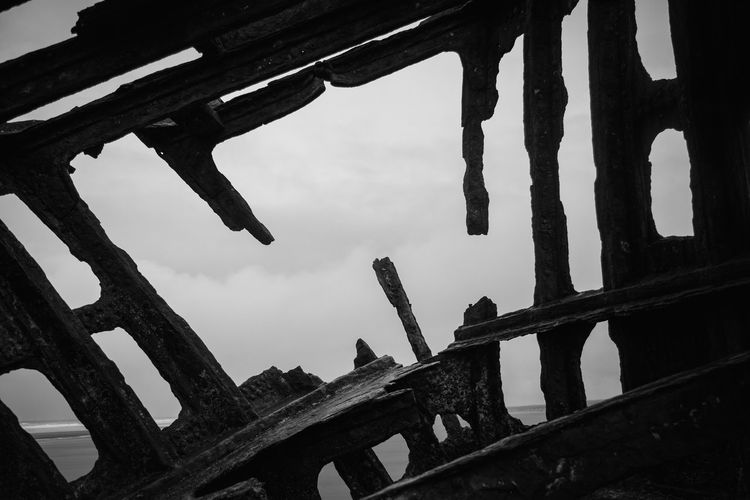Ship Wreck Wreck Architecture Built Structure Close-up Cold Temperature Contrast Day Frame Girder Low Angle View Nature No People Outdoors Sky Water