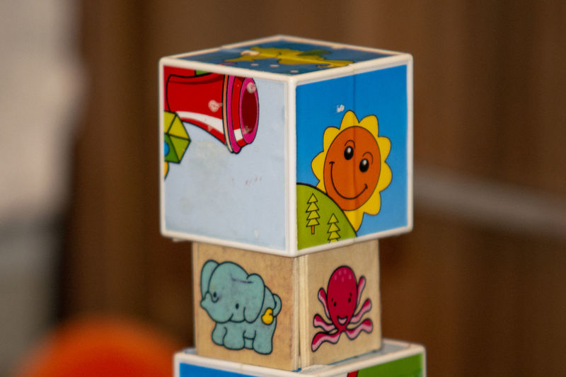 Representation Creativity Toy Art And Craft Human Representation Indoors  No People Focus On Foreground Close-up Multi Colored Wood - Material Male Likeness Craft Box Smiling Female Likeness Blue Still Life