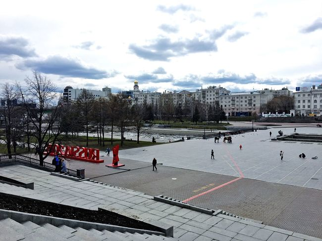 Russia. Ekaterinburg Built Structure Architecture Cloud - Sky Large Group Of People Building Exterior Ice Rink Sky Day City Winter Sport Travel Destinations Men Outdoors People Ice Hockey Sport Women Hockey Real People Adult