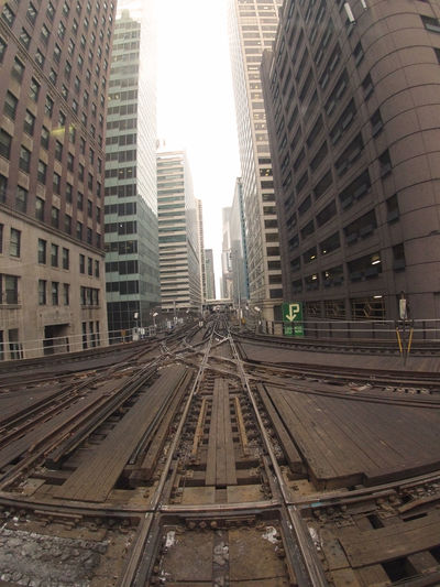 Conjunct and Divide Architecture Building Exterior Built Structure Chicago Chicago El City Cityscape Commute Commuter Train Day Industrial No People Outdoors Public Transportation Rail Transportation Railroad Track Sky Skyscraper Tracks Train Train Tracks Transportation Travel Urban Gopro Neighborhood Map The Street Photographer - 2017 EyeEm Awards The Architect - 2017 EyeEm Awards EyeEmNewHere