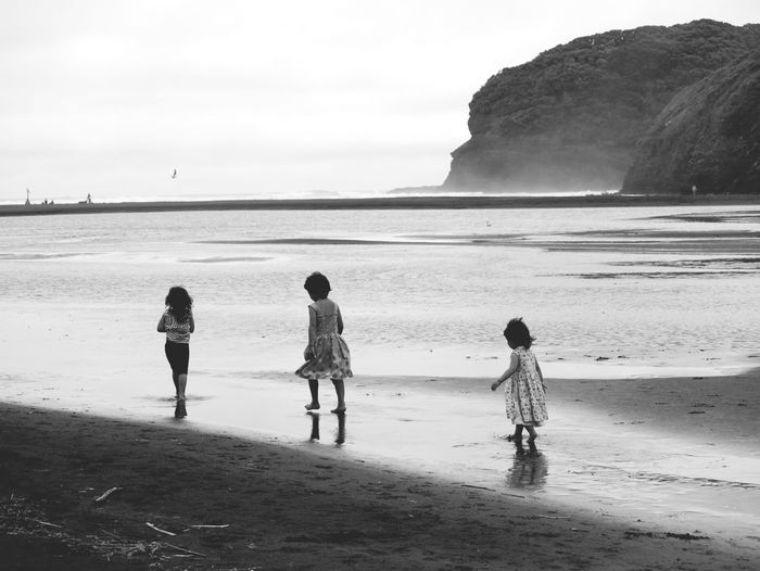 Bethells beach nz a few years ago with my girls. Beach Sea Water Togetherness Sand Landscape Outdoors Scenics Full Length People Child Nature Beauty In Nature Day Sky Children Only Adult Horizon Over Water Lost In The Landscape Exploring Beauty