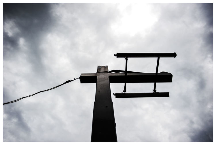Low Angle View Of Electricity Pole
