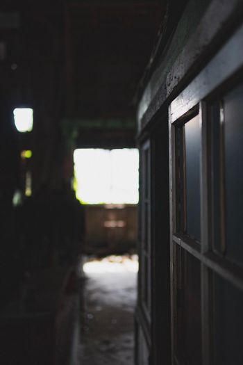 Indoors  Architecture No People Building Built Structure Arcade Punishment Corridor Entrance Door Window Focus On Foreground Day Metal Prison Dark Prison Cell Nature Safety