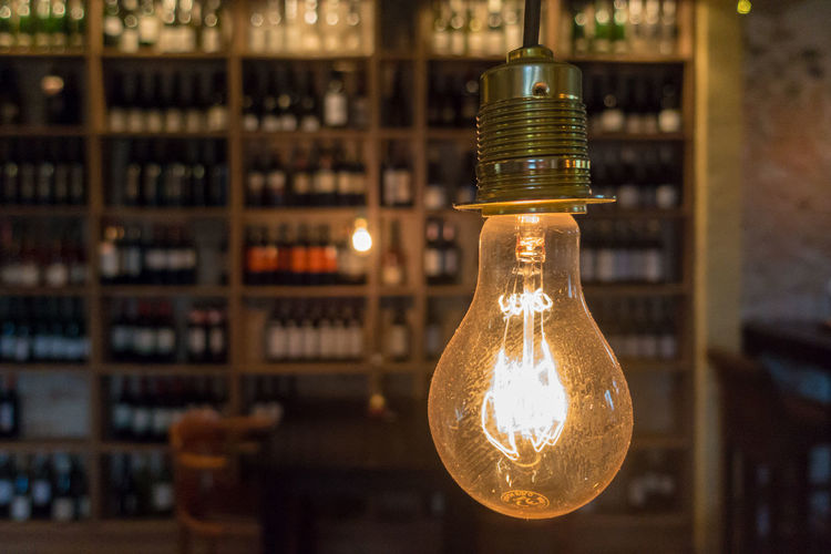 Electric Bottle Bottles Bulb Close-up Day Electric Bulb Electricity  Filament Focus On Foreground Illuminated Indoors  Light Bulb No People Wine Modern Workplace Culture