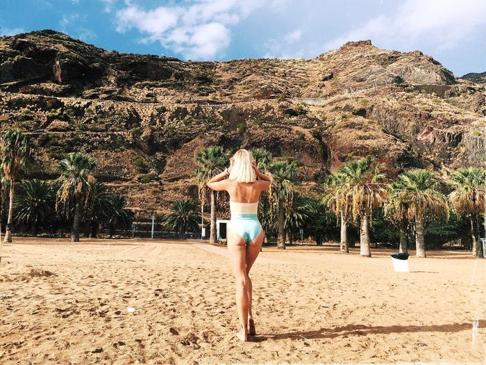 Rear View Real People Sand Nature Day Sky Lifestyles Young Women Young Adult Beauty In Nature Beach Standing Women Vacations Cloud - Sky Leisure Activity Outdoors One Person