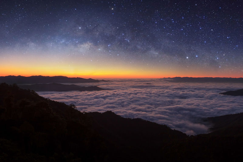 Milky way galaxy over foggy mountains in Thailand. Astronomy Beauty In Nature Galaxy Nature Night No People Outdoors Scenics Sea Sky Star - Space Sunset Tranquil Scene Tranquility Water