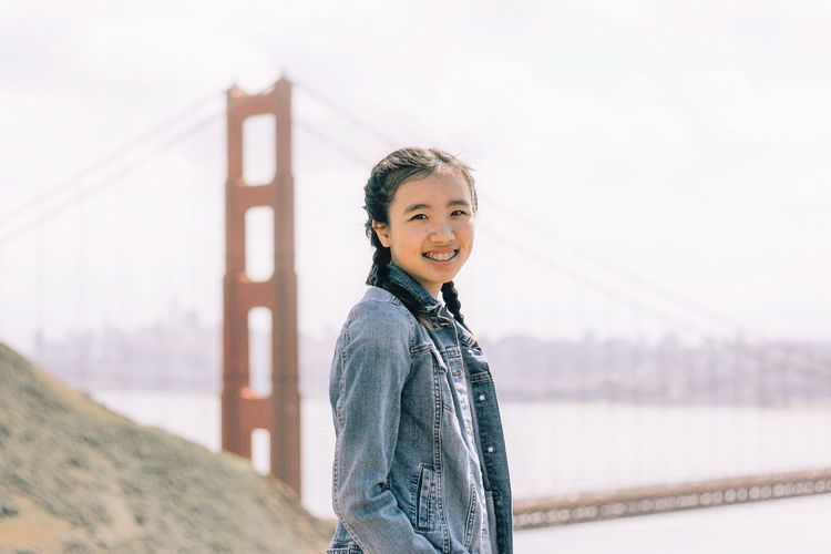 san francisco California San Francisco Girl EyeEm Selects One Person Winter Real People Nature Standing Portrait Sky Warm Clothing Looking At Camera Smiling Lifestyles Day Clothing Waist Up Outdoors