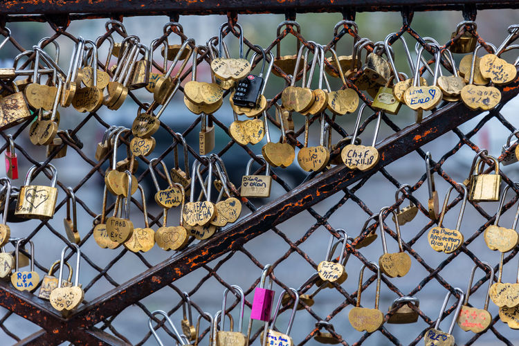 Low angle view of padlocks hanging on metal structure