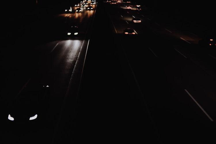 High angle view of illuminated road at night
