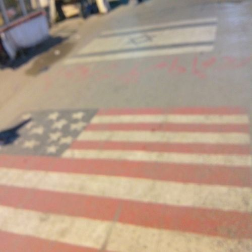 American & Israeli flag on road.