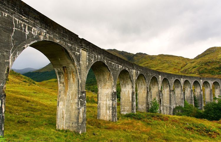 I just love this picture. Even more than the one I got with the train on it. It's something with the viaduct both cutting into and completing the nature... Glenfinnan Glenfinnan Viaduct Hogwarts Express Scotland Highlands