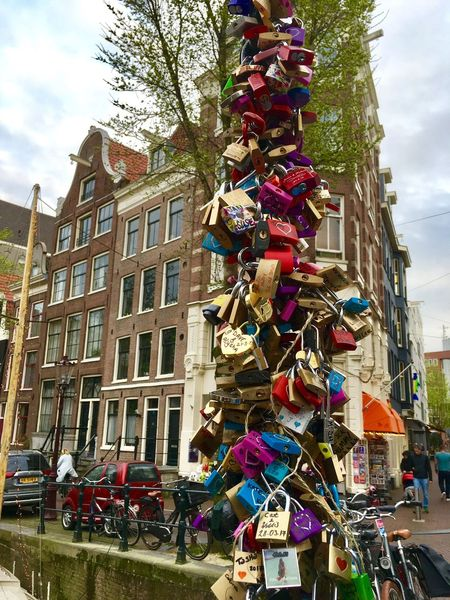 Amsterdam Canals Locks Architecture Variation Building Exterior Hanging Built Structure Outdoors Day Sky Low Angle View Multi Colored Large Group Of Objects Love Lock Tree No People City EyeEmNewHere