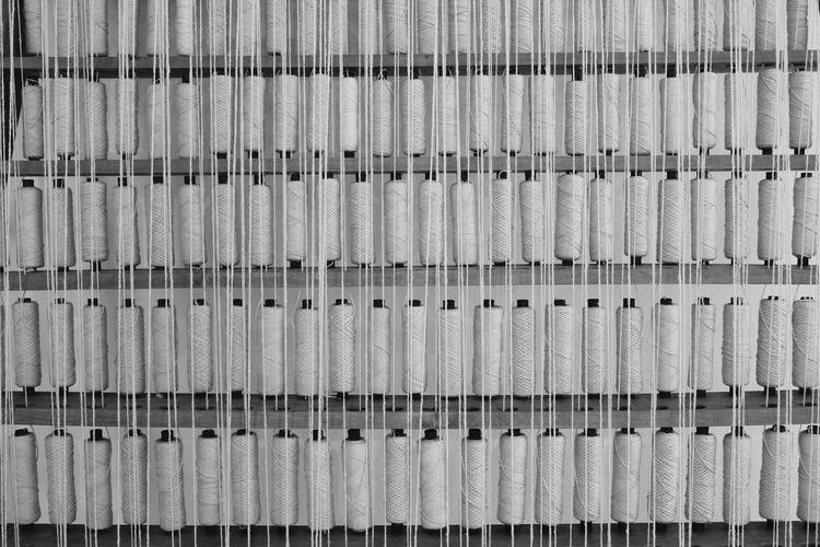 Full Frame Shot Of Thread Spools