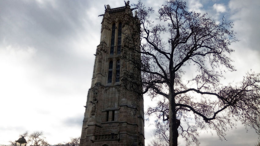 Tour Saint-Jacques, Paris EyeEmNewHere France Paris Tour Saint-Jacques Architecture Bare Tree Bell Tower Building Exterior Built Structure Clock Tower Cloud - Sky Day History Low Angle View Nature No People Outdoors Place Of Worship Religion Sky Tour Tower Tree