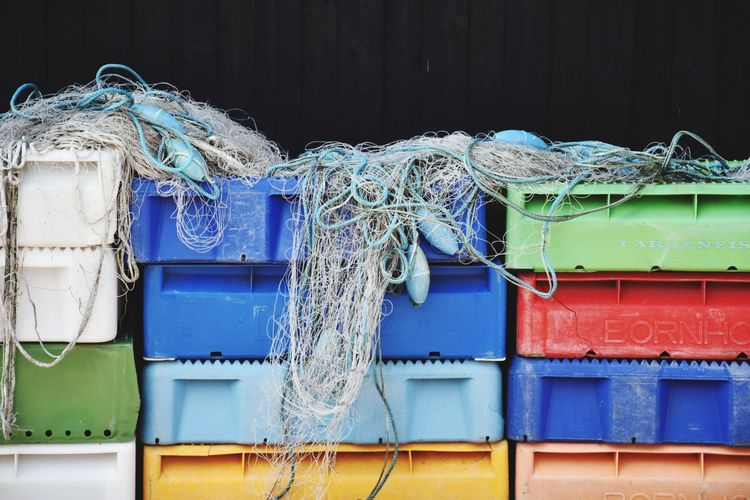 Buoys And Fishing Nets On Colorful Crates