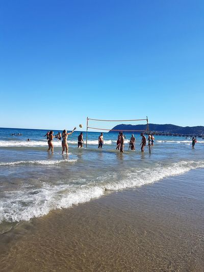 Beach Large Group Of People Sunny Sea Sky Outdoors Day Horizon Over Water Water Sand Sport Blue Standing People Sportsman Nature Adult Men Togetherness Adults Only Beachvolley Liguria, Italy Alassio Liguria Summer Sports