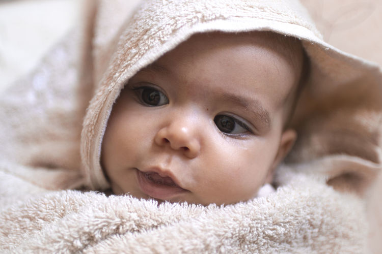 Close-up portrait of cute baby lying down