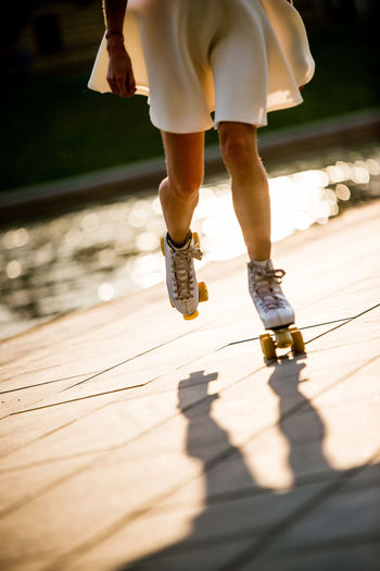 Riding Roller Coasters Activity Human Body Part Human Leg Leisure Activity Lifestyles Low Section Outdoors Rollerskate Rollerskates Rollerskating Rolling Shadow Sports Sunlight