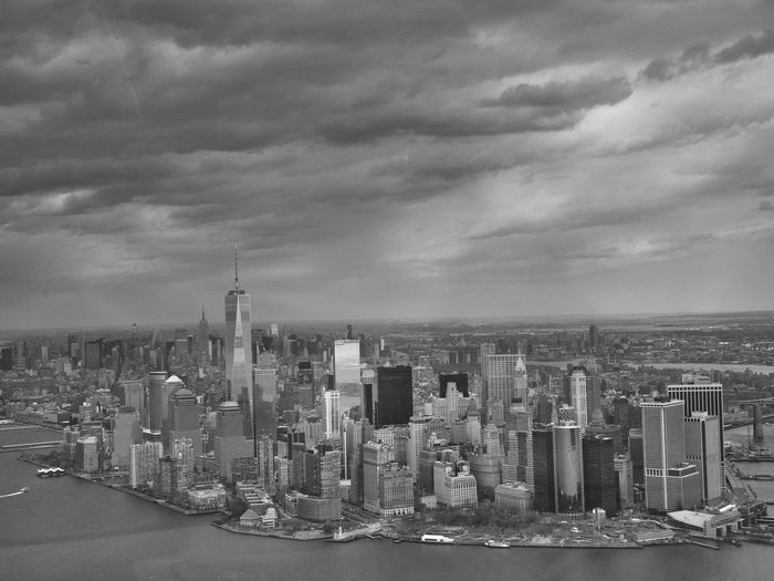 Cityscape With One World Trade Center Against Cloudy Sky