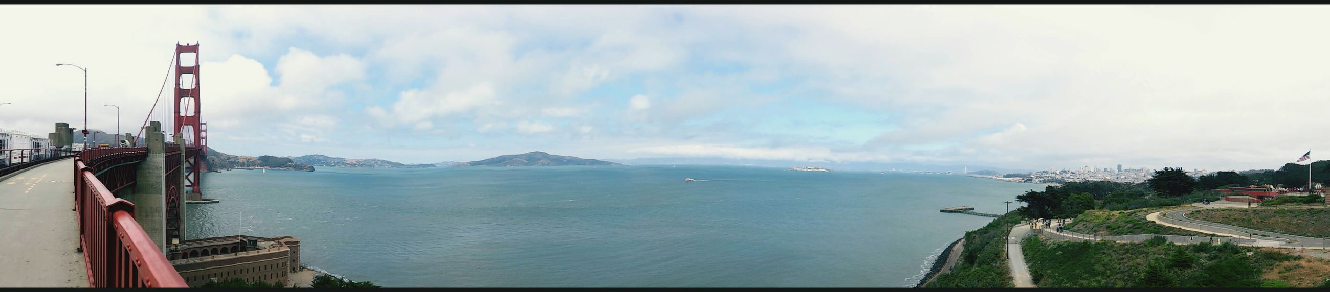 water, sea, sky, panoramic, transportation, scenics, mountain, nature, cloud - sky, beauty in nature, transfer print, tranquil scene, tranquility, horizon over water, built structure, nautical vessel, auto post production filter, day, cloud, mode of transport